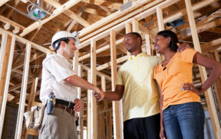 A Couple Shaking Hands with Their Affordable Home Builder